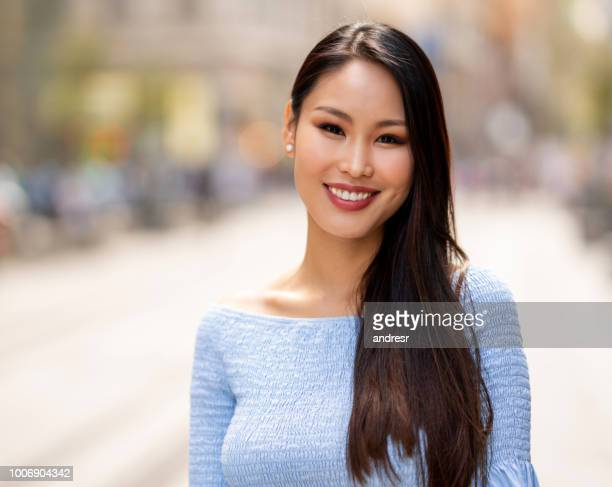 portrait of a beautiful asian woman smiling - mongolian models stock pictures, royalty-free photos & images