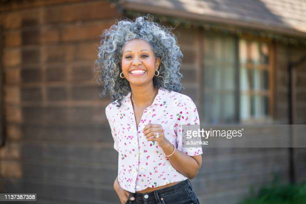 portrait of a beautiful black woman outdoors - white hair stock pictures, royalty-free photos & images