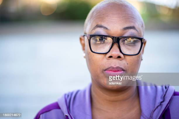 portrait of a beautiful black woman. - adamkaz stock pictures, royalty-free photos & images
