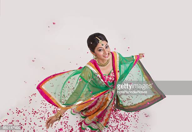 portrait of a beautiful bride surrounded by rose petals - dupatta stock pictures, royalty-free photos & images
