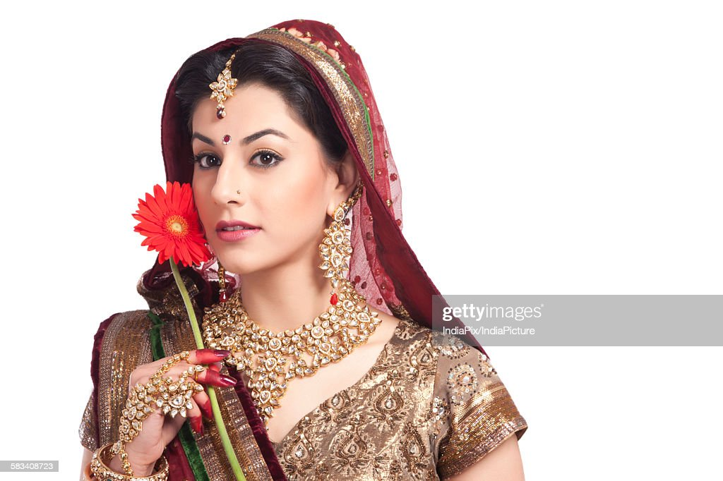 Portrait of a beautiful bride with a flower : Stock Photo