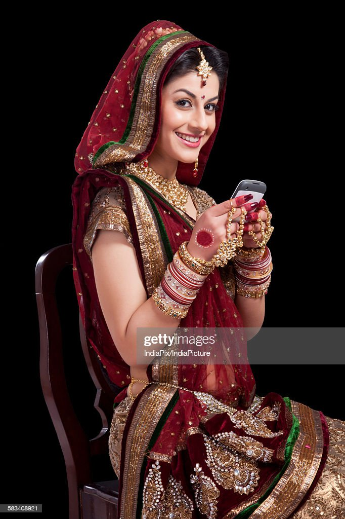 Portrait of a beautiful bride with a mobile phone : Stock Photo