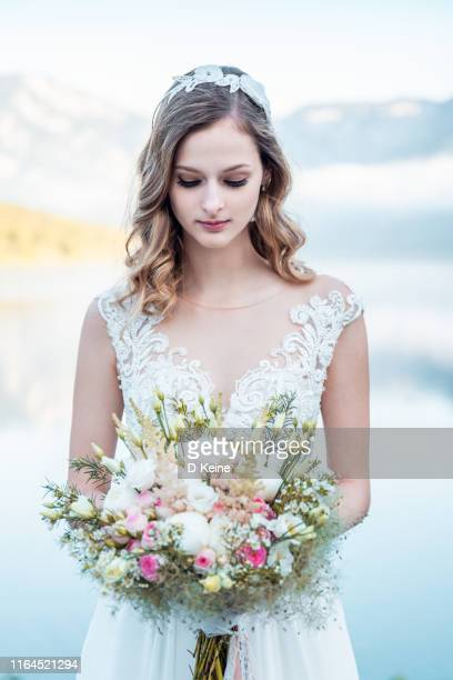 portrait of a beautiful bride with flowers - 2019 stock pictures, royalty-free photos & images
