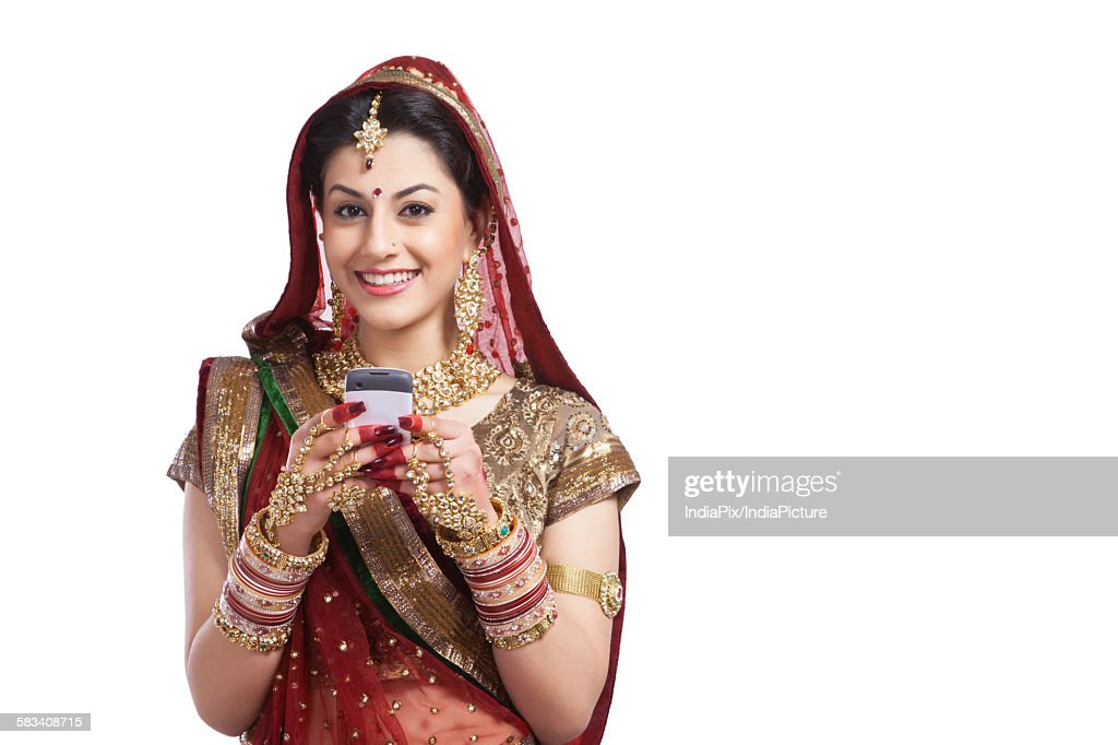 Portrait of a beautiful bride with mobile phone : Stock Photo