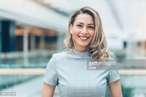 portrait of a beautiful businesswoman - blonde hair stock pictures, royalty-free photos & images