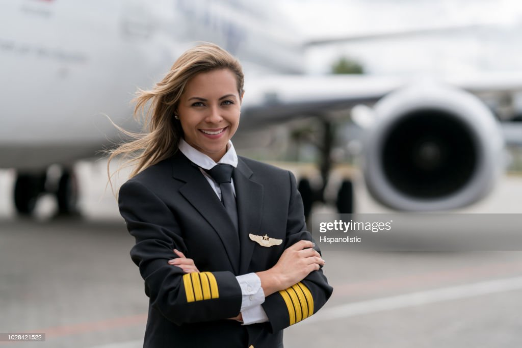 Portrait of a beautiful female pilot : Stock Photo