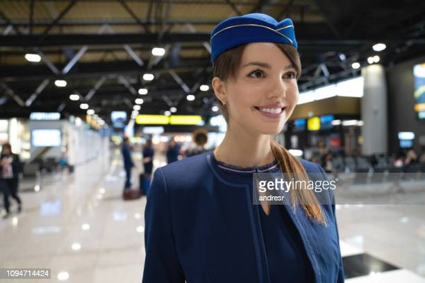 Portrait of a beautiful flight attendant working at the airport