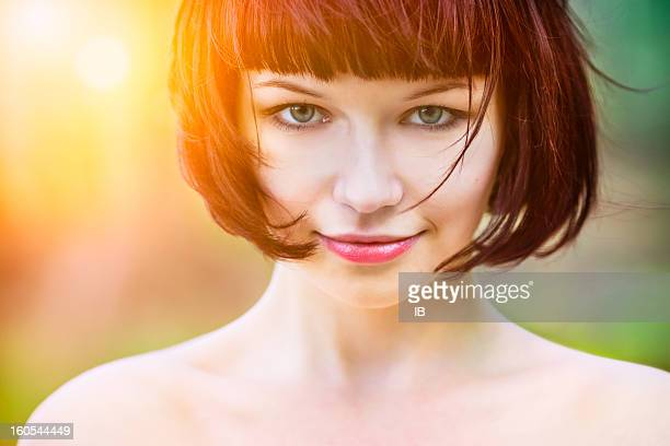Portrait of a beautiful girl in sunlight