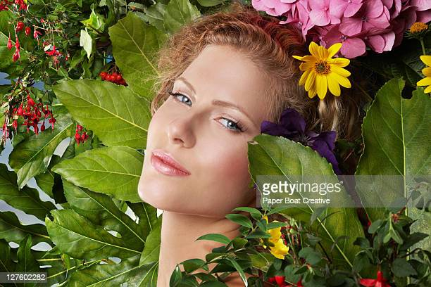 portrait of a beautiful girl resting on flowers