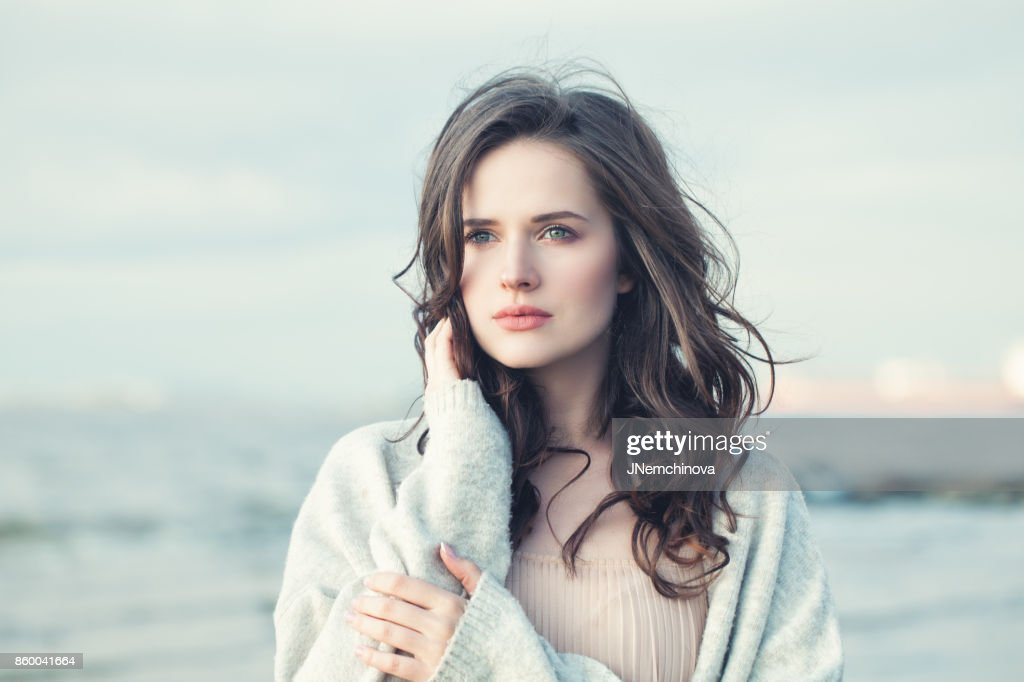 Portrait of a Beautiful Girl with Curly Hair on a Cold Windy Day Outdoors : Stock Photo