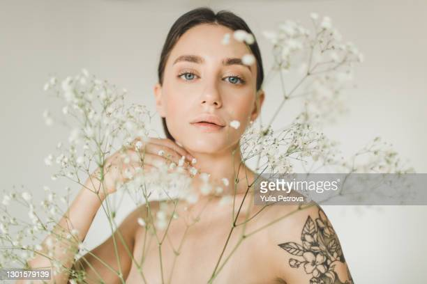 portrait of a beautiful girl with flowers with nude makeup on a white background - freshness stock pictures, royalty-free photos & images