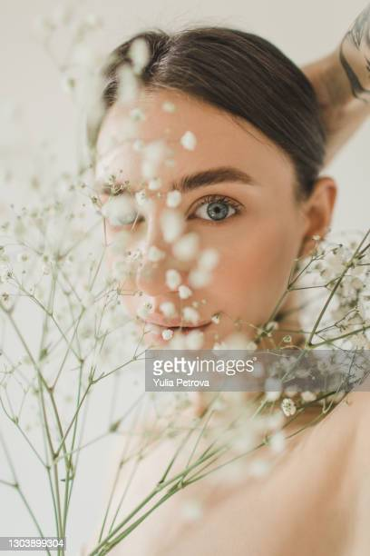 portrait of a beautiful girl with flowers with nude makeup - freshness stock pictures, royalty-free photos & images