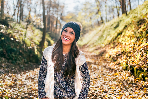 Portrait of a beautiful happy woman in an autumnal forest - gettyimageskorea