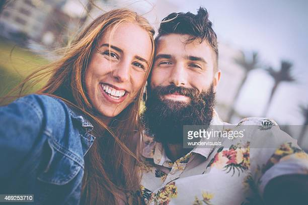 Portrait of a beautiful hipster couple looking happy