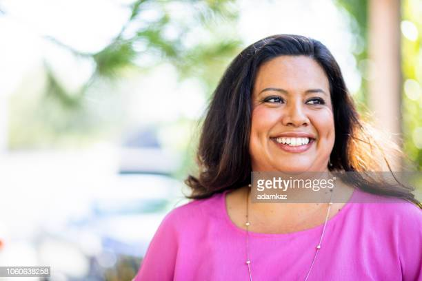 portrait of a beautiful hispanic woman - only women stock pictures, royalty-free photos & images