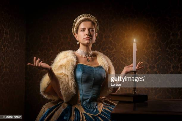 portrait of a beautiful historical dutch noble woman by candlelight - historical clothing stock pictures, royalty-free photos & images