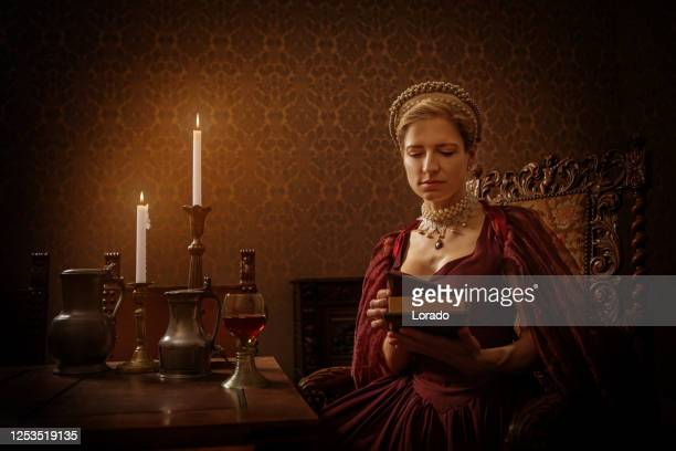 portrait of a beautiful historical dutch noble woman by candlelight - 1600s stock pictures, royalty-free photos & images