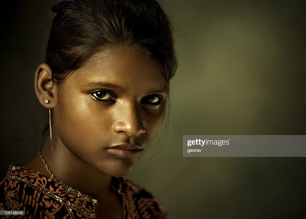Portrait of a beautiful Indian young woman looking at camera : Stock Photo