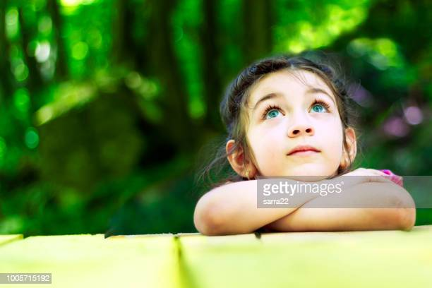 portrait of a beautiful little girl - curiosity stock photos and pictures