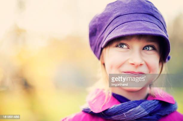 portrait of a beautiful little girl - purple hat stock pictures, royalty-free photos & images