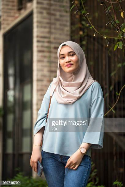 portrait of a beautiful malaysian girl - malay hijab stock photos and pictures