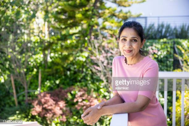 portrait of a beautiful mature indian woman - mid adult stock pictures, royalty-free photos & images