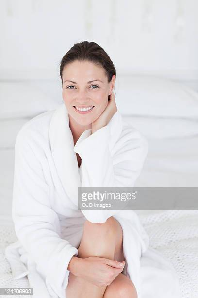 Portrait of a beautiful mid adult woman smiling in bathrobe