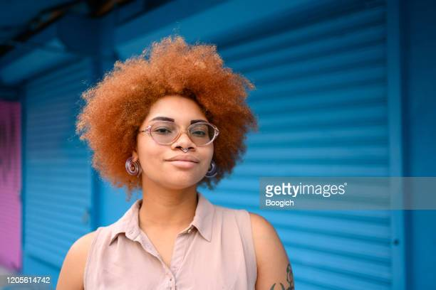 portrait of a beautiful mixed race woman with natural hair in wynwood miami - showus stock pictures, royalty-free photos & images