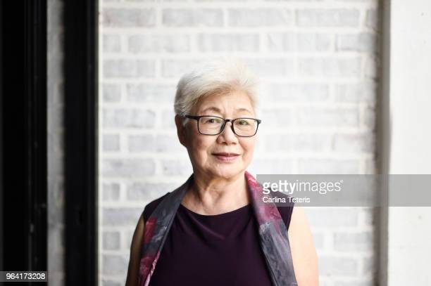 portrait of a beautiful senior malaysian woman - white hair stock photos and pictures