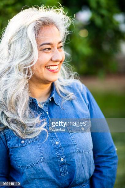portrait of a beautiful senior mexican woman - fat nutrient stock pictures, royalty-free photos & images