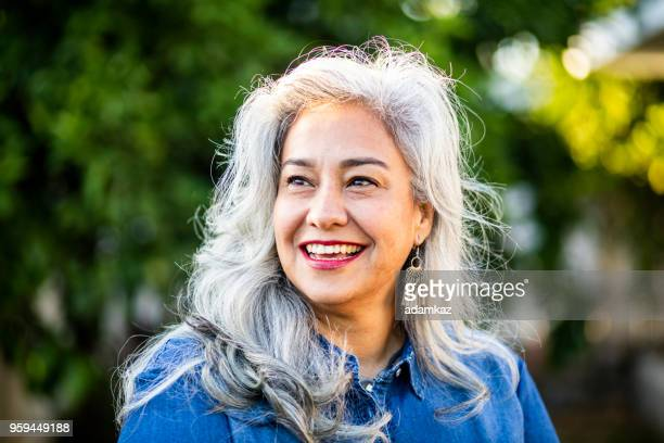 portrait of a beautiful senior mexican woman - latin beauty stock pictures, royalty-free photos & images