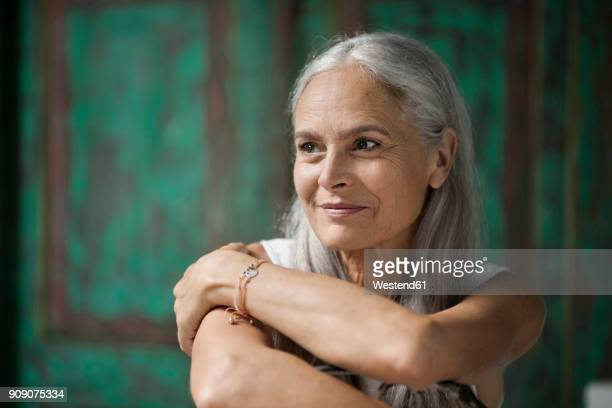 portrait of a beautiful senior woman - 60 64 years stock pictures, royalty-free photos & images