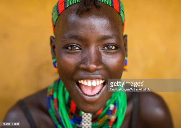 Portrait of a beautiful smiling Hamer tribe woman Omo valley Dimeka Ethiopia on June 10 2017 in Dimeka Ethiopia