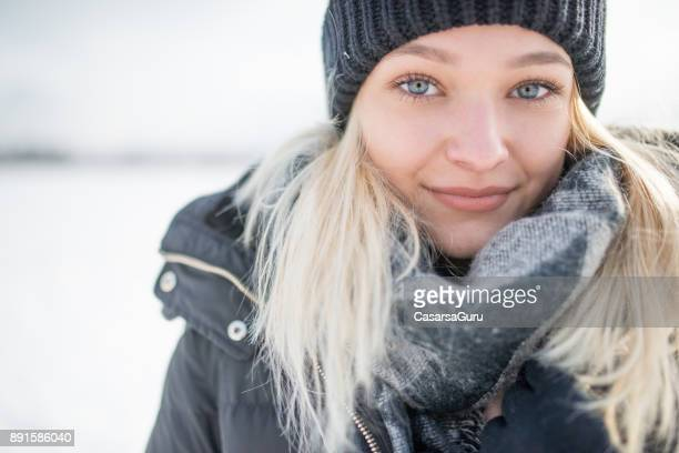 Portrait of a  Beautiful Smiling Teenaged Woman Outdoors in Winter time