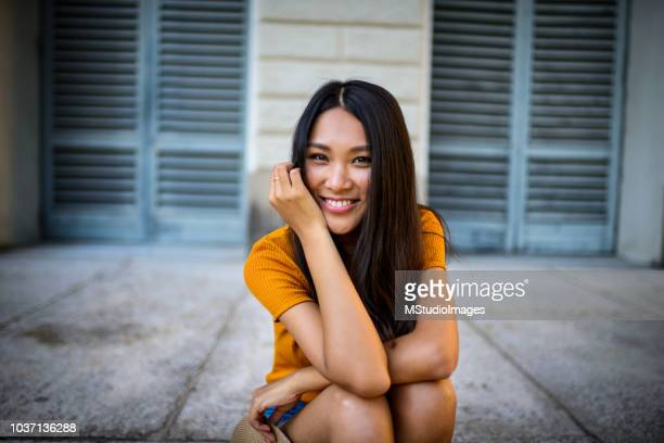 portrait of a beautiful smiling woman. - asian model stock photos and pictures
