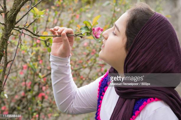 portrait of a beautiful teenage girl outdoor in a garden - iranian culture stock photos and pictures