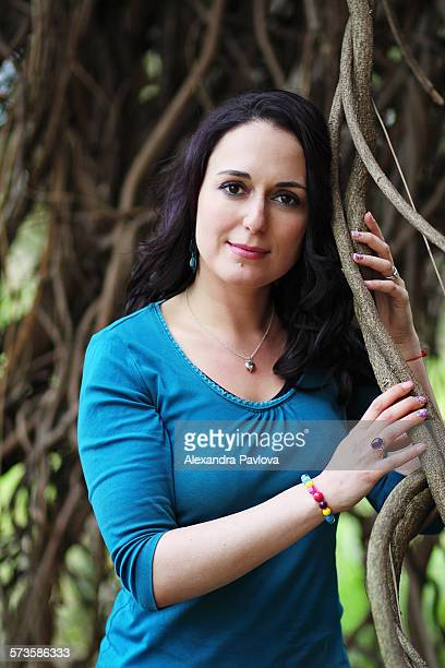 Portrait of a beautiful woman among bare branches