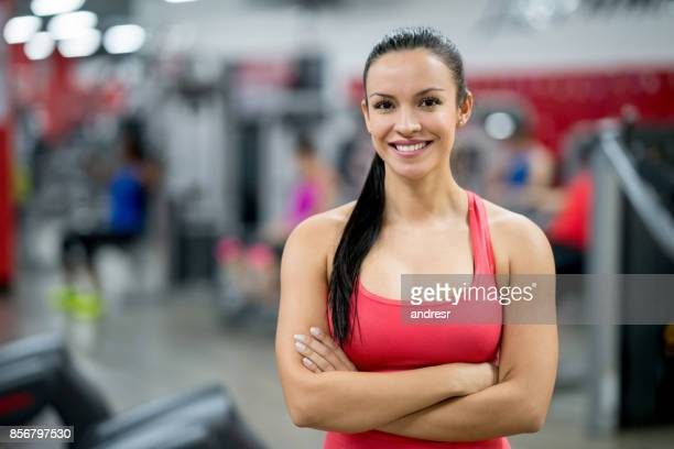 portrait of a beautiful woman at the gym - coach stock pictures, royalty-free photos & images