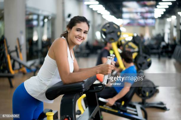 Portrait of a beautiful woman exercising at the gym