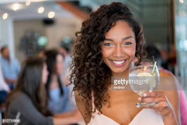 Portrait of a beautiful woman having drinks at a bar