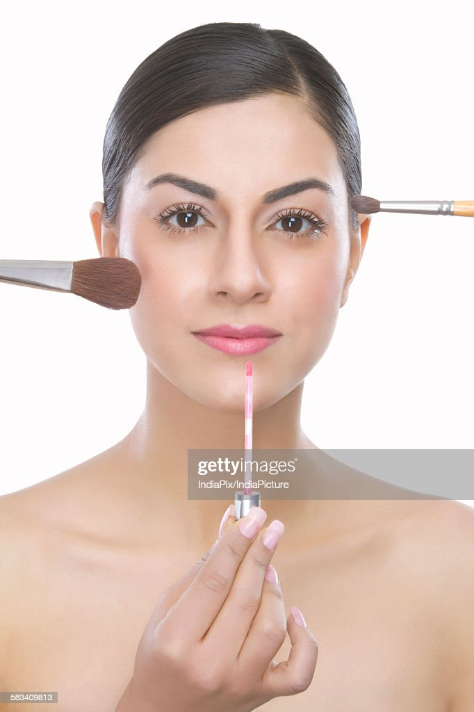 Portrait of a beautiful woman holding : Stock Photo