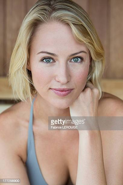 portrait of a beautiful woman in a sauna - cleavage stock pictures, royalty-free photos & images