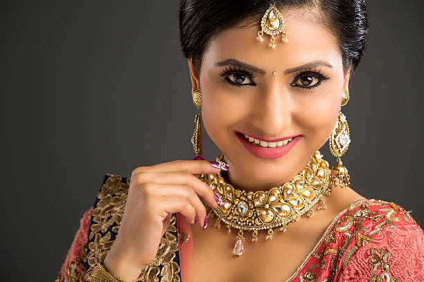 Free beautiful indian girl images pictures and royalty free portrait of a beautiful woman in glamorous outfit and jewellery voltagebd Images