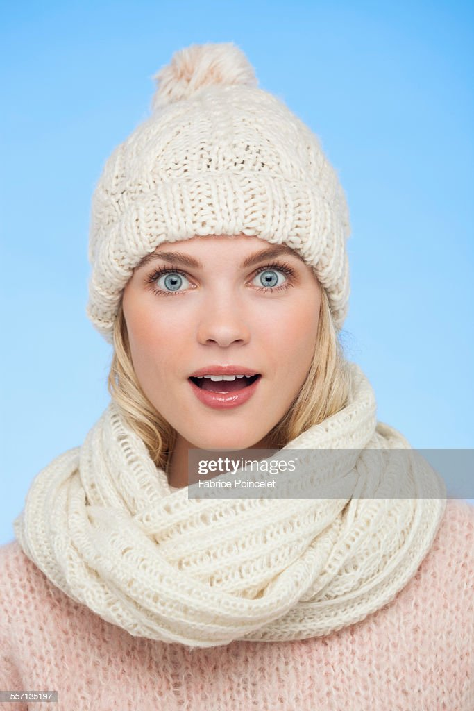 Portrait of a beautiful woman looking surprised : Stock Photo