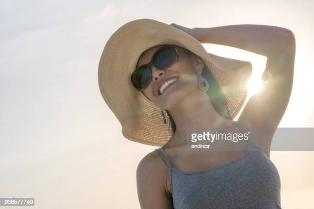Portrait of a beautiful woman outdoors enjoying the summer
