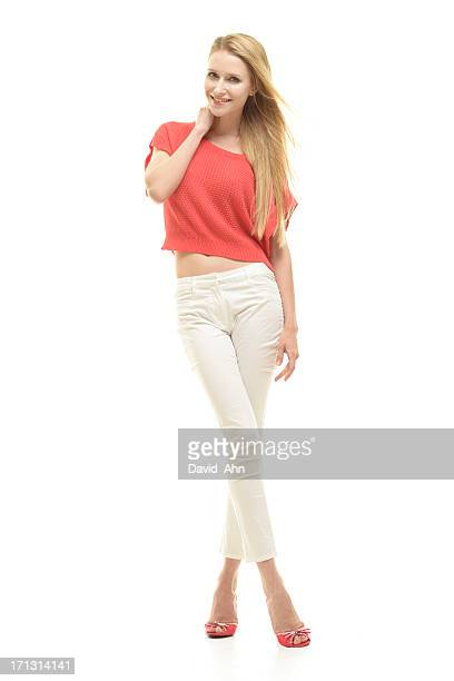 portrait of a beautiful woman - white pants stock pictures, royalty-free photos & images