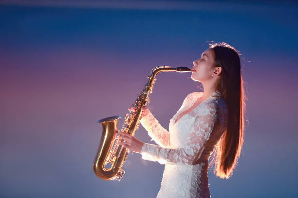 Portrait of a beautiful woman playing the saxophone