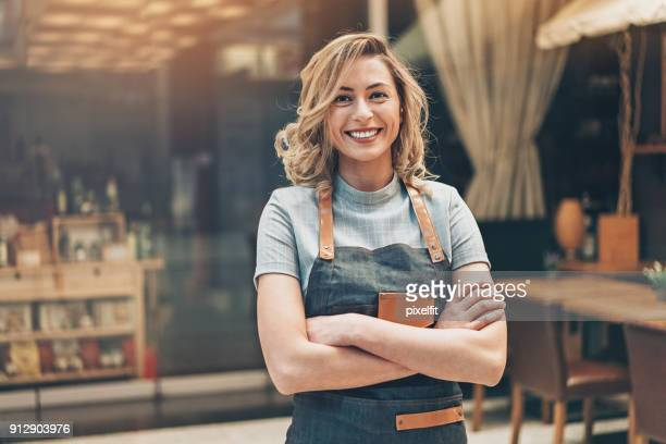 portrait of a beautiful woman small business owner - business owner stock photos and pictures