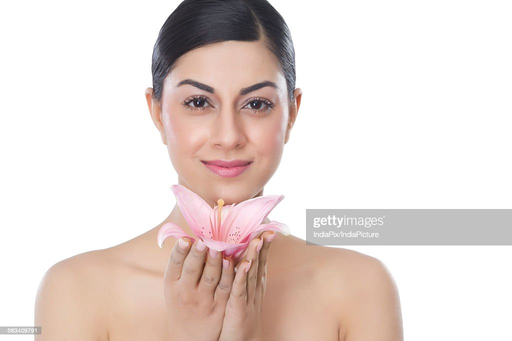 Portrait of a beautiful woman with a flower : Stock Photo