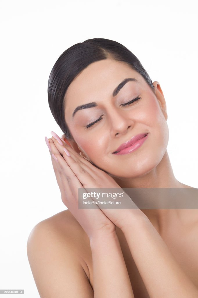 Portrait of a beautiful woman with eyes closed : Stock Photo